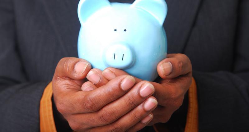 Man holding a piggy bank